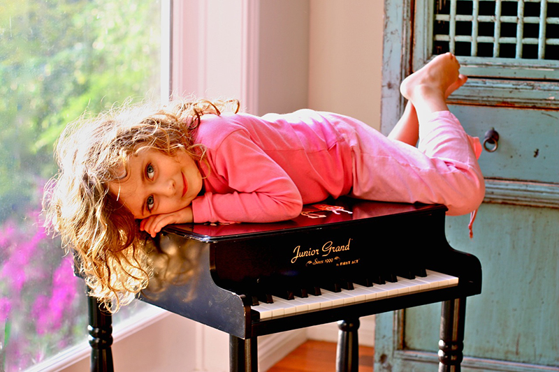 portrait young girl junior piano