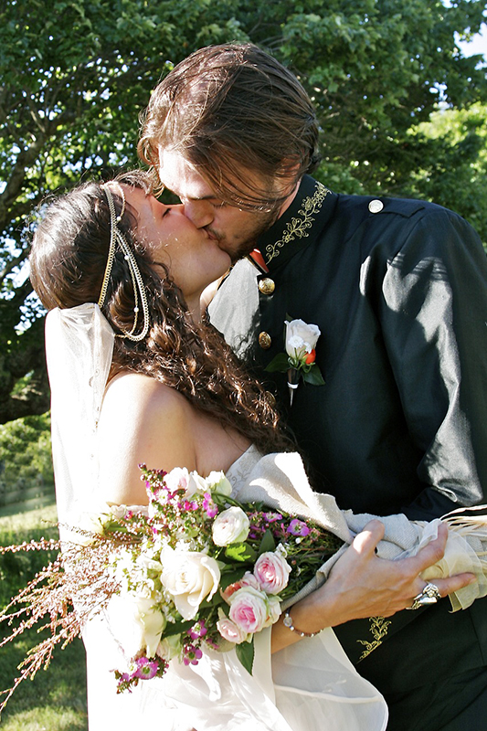 bride and groom kiss after wedding