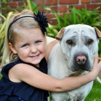 portrait blonde girl with dog