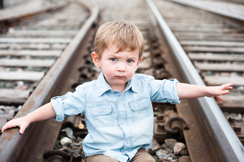 toddler_boy_train_traintracks_railwaytracks_portrait_lifestyle