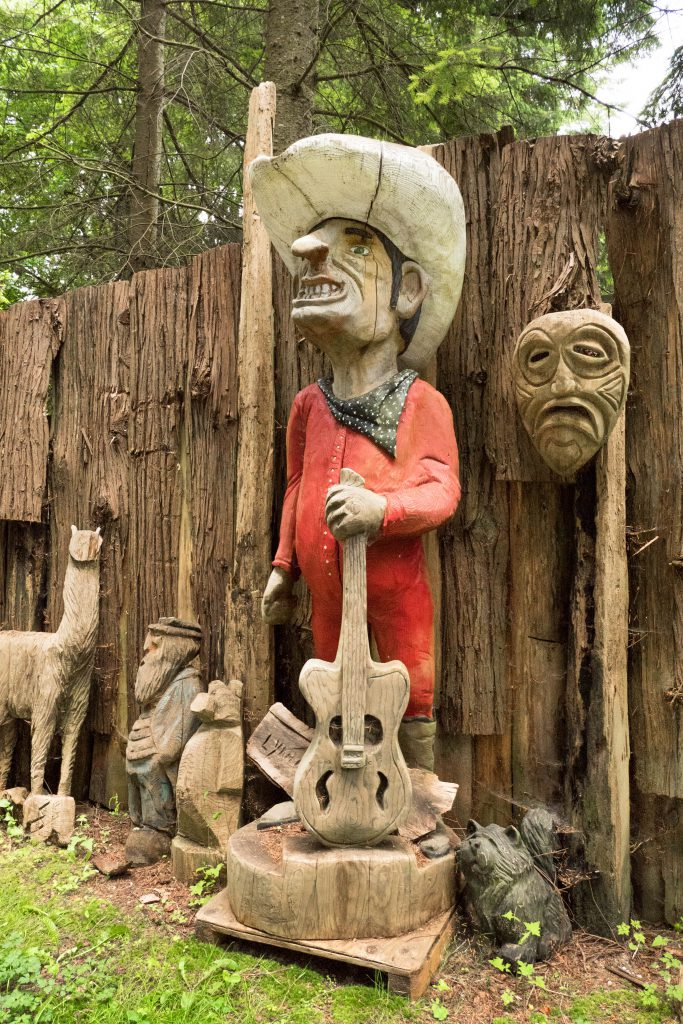 Washington, Whidbey, Whidbey Island, chainsaw carvings, chainsaw fence, flowers, island